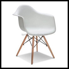 Plastic dining chair with wooden legs