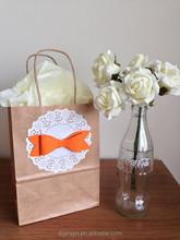 Orange tie paper bags with handles/flat handle kraft paper bag