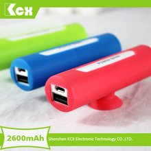 Promotion corporate gift ! wholesale power bank 2600mah portable battery charger with mobile phone sucker holder