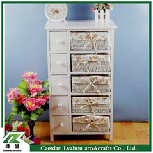 Tall wood cabinet have many drawers and baskets for storage