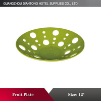 green round ceramic fruit pierced plate