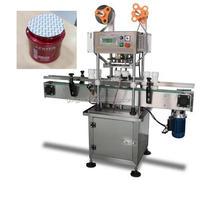 Cosmetic plastic jar aluminum foil roll film heat sealing machine