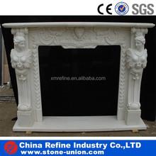 white stone fireplace statues