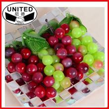 gruppo di artificiale uva in plastica per giardino di casa arredamento foto prop