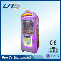 UNIS hot sale coin operated PUSH PRIZE MACHINE/TOY CLAW MACHINE for mall