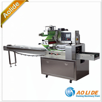 Automatic peanuts wrapping pillow packing machine