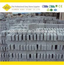 g603 construcstion svolgendo la mattoni di granito