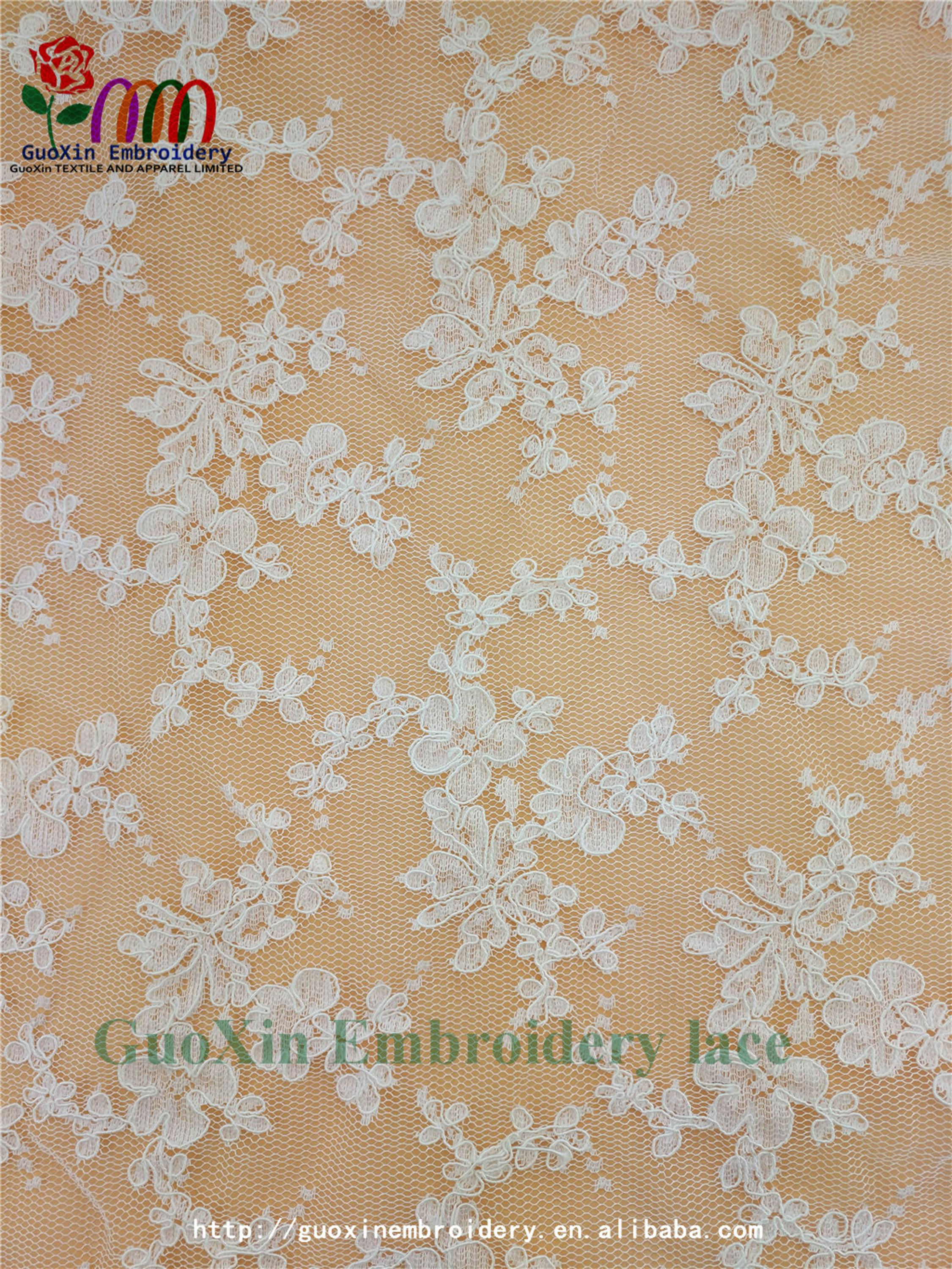 factory wholesale ivory embroidered french lace fabric with cording (4).jpg