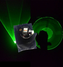 Green laser glove with dancing stage light