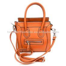 Trendy smiling face lady fashion handbag in Orange