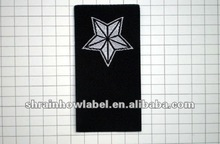 Black damask woven labels with silver white star
