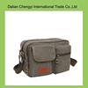 Factory price trendy solid leisure men canvas shoulder bag with multi pockets