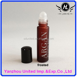 Purple frosted roll on glass eye essence bottle with black cap