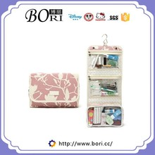small women hanging cosmetic travel bag with compartments