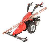 Grillo tractor with heavy-duty grass mowing machine