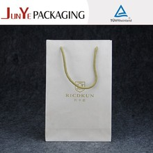 wholesale brand printed custom eco friendly glossy promotional pp handle paper shopping bags