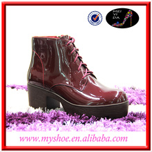 Red leather shoes with thick bottom