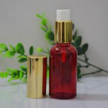 1 oz rouge ronde huile essentielle bouteilles en verre avec pompe de pulvérisation gros