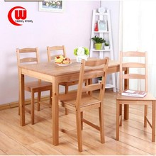 A simple table of pine wood from a table and four chairs Dining Table
