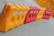 Old Water Filled Barrier (three hole) plastic road barrier