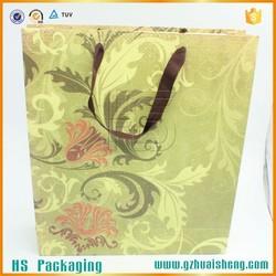 Custom brand name OEM production paper shopping bag gift bag