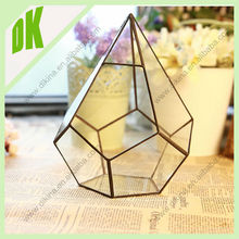 The glass vase is mouth blown by a skilled craftsperson, hanging teardrop shaped glass vase geometric stained glass terrarium