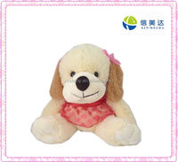 Cute plush toy dog with red scarf