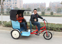 pedal-operated cargo tricycle witn cabin