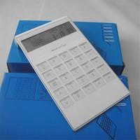 Desktop calculator with alarm clock and world time display