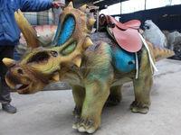 Amusement park type mechanical people riding on walking dinosaur