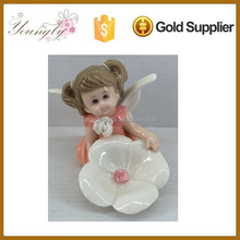 Popular angel with folwer white porcelain angle for home decoration