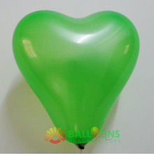 Heart shaped green latex ballon