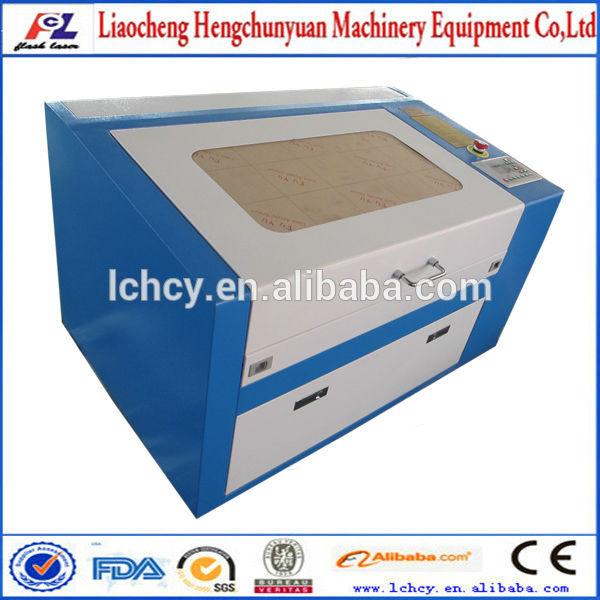 laser fournitures de gravure de gros/co2 gravure au laser découpe prix de la machine