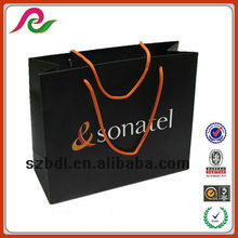 Recyclable paper gift bag with coated paper