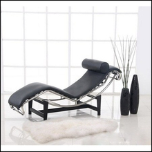 Le Corbusier Chaise Lounge Chair with metal base and cow leather, wooden rocking chair