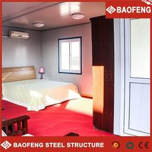 Low cost flat pack multi bounce container house with