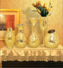 glass mirror and gold mosaic candle holders and vases