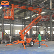 Towable spider boom lift for aerial work for picking up