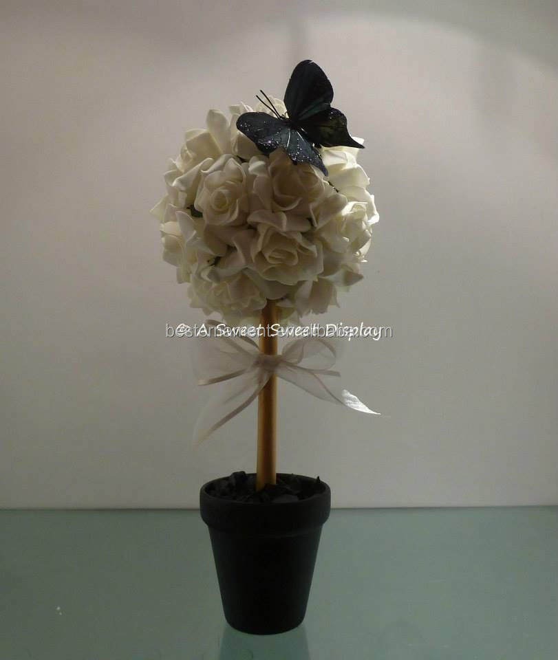 Foam rose topiary trees wedding centrepiece view
