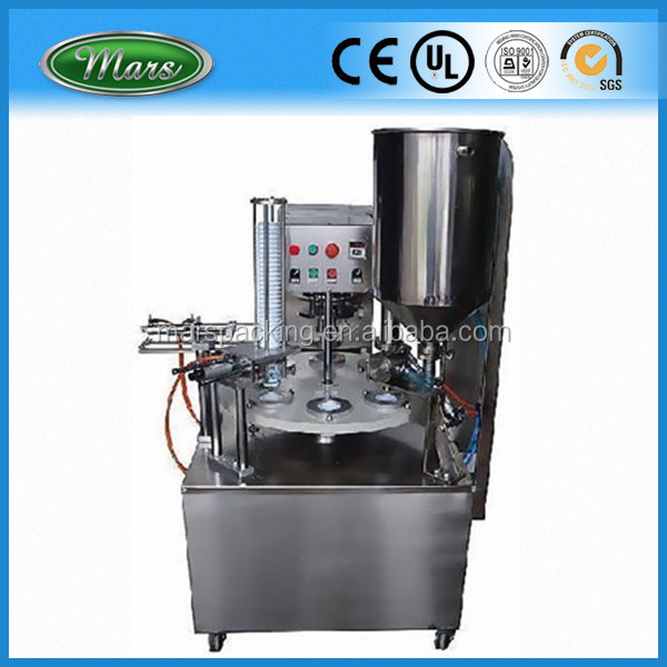 rotary cup filling and sealing machine