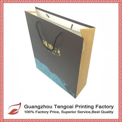 Customized ivory board black color printing cheap handmade advertising paper bag