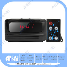 Digital black camera clock with remote control and motion detection