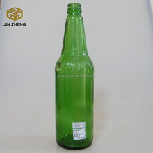 550ml empty green glass beer bottle with metal caps wholesale in china