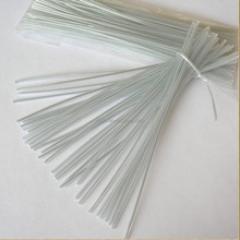 Hot sale oval flat clear plastic twist tie roll with cutter for satin ribbon gift toy packaging