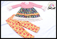 Bulk wholesale childrens boutique clothing alphabet lacework tops and cotton pants from Yiwu China.