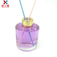 Hot sell 130ml fragrance round reed diffuser glass bottle container with gold screw cap