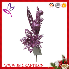 Artificial glitter Christmas flower with apple and berry