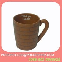 Terracotta mugs and coffee cup