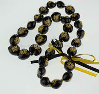 Black Kukui Nut Leis with Yellow Painted Flower
