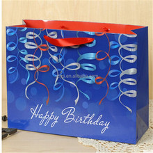 Yiwu factory manufacture / happy birthday paper gift bags with colored ribbons print